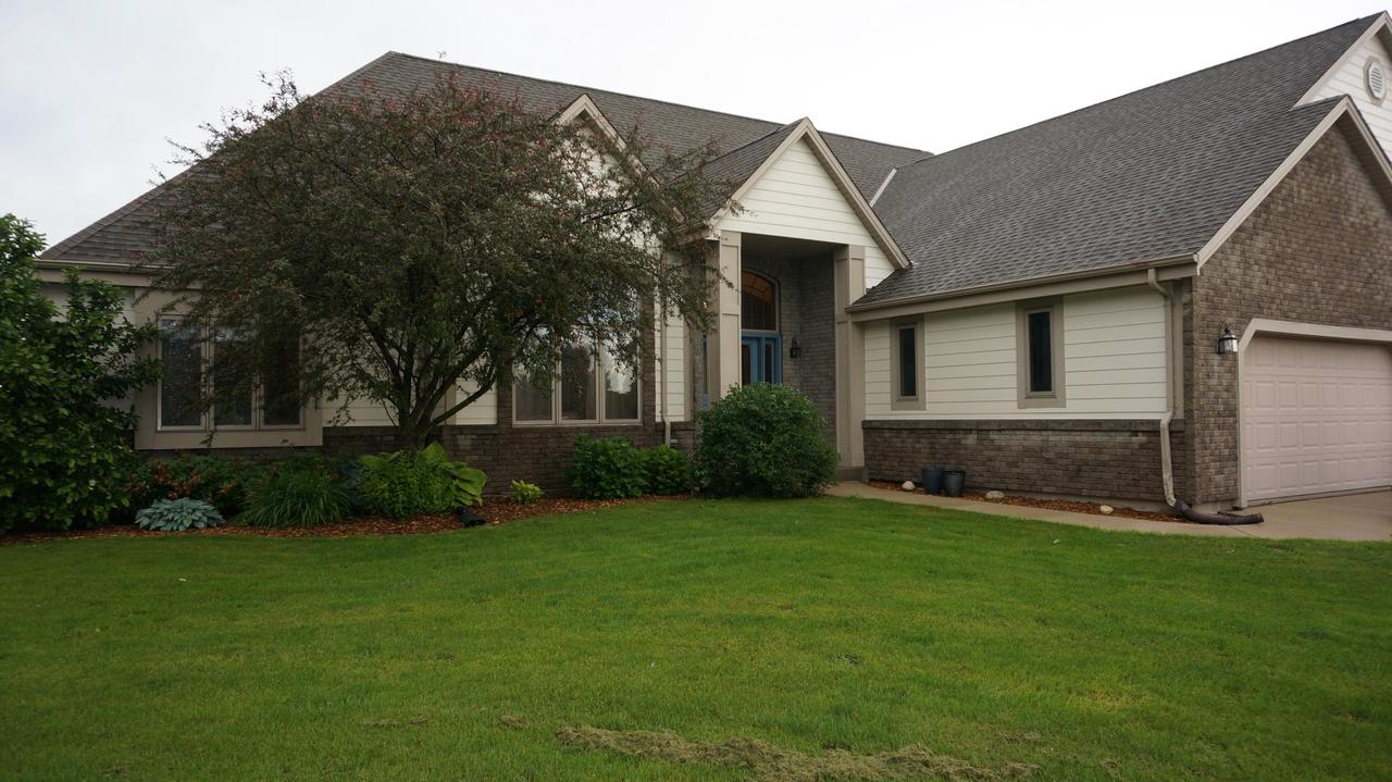 Don't miss your chance to own this stunning 5 Bedroom Split ranch with 3 full baths on a gorgeous 1.29 acre lot.   This home features over 4600sq ft of living space.  Enter into the beautiful foyer overlooking the great room with gas fireplace and lots of windows allowing an abundance of natural light.Dining room with  arched doorways will amaze you.Custom Birch Kitchen Cabinets, Hardwood floors in kitchen, dining room, office, & foyer.  Master bedroom offers on suite bathroom with whirlpool tub.Entertainiing in the lower level is waiting for you with the pool table and large exposed windows. 6 panel doors, new carpet through out, newer windows, 4 car garage with upper large storage area. Enjoy this beauty this summer from the large deck over looking your beautiful lot and wildlife.