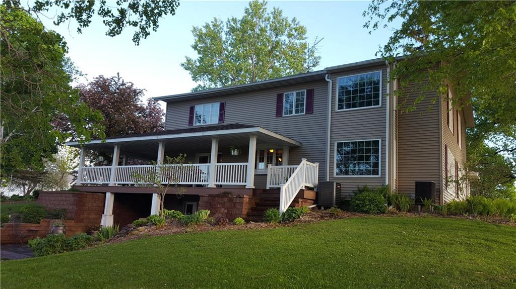 20 acre hobby farm, 4 bedroom, 6 bath home featuring 2 master suite bedrooms. Kitchen has granite counter tops, double wall oven w/ gas cooktop, high end stainless steel appliances, recently updated floors with combination of engineered hardwood and carpeting. Phenomenal view from wrap around composite deck/covered porch with recessed lighting all the way around for relaxing evenings. Walkout basement to beautiful stamped concrete patio. 2 pole sheds, Heated Barn, green house, machine shed.