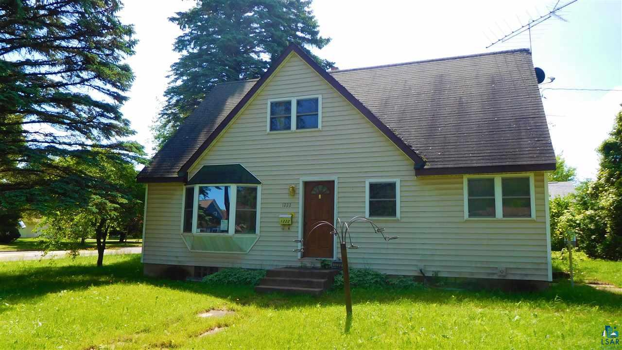 This property would be a good starter home located near downtown Ashland on a larger city lot. One and one half story, two bedroom, one bath house with master bedroom and bath on main floor, upper finished level with den and one car detached garage.