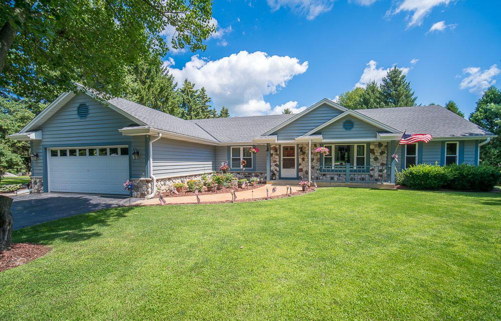 Here's a stunning well maintained open concept 3 bedroom 2.5 bath ranch home with a country lot.  Updated gourmet kitchen with vaulted ceilings, maple cabinets, stainless steel appliances, walk-in pantry and island. Beautiful bay windows surround dinette area. Large living room with NFP. Large den perfect for an office or play room. Over sized master bedroom with deep walk-in closet, on suite with jetted tub and walk-in shower. 2 other spacious bedrooms with plenty of closet space. 1st floor laundry. Long mudroom off 2 car attached garage. Finished LL with pool table, large storage room. Enjoy the views of the private manicured lawn on your concrete stamped patio or on the deck with above ground pool. Newer mechanics throughout home - water heater, furnace, a/c, roof. Move-in Ready!