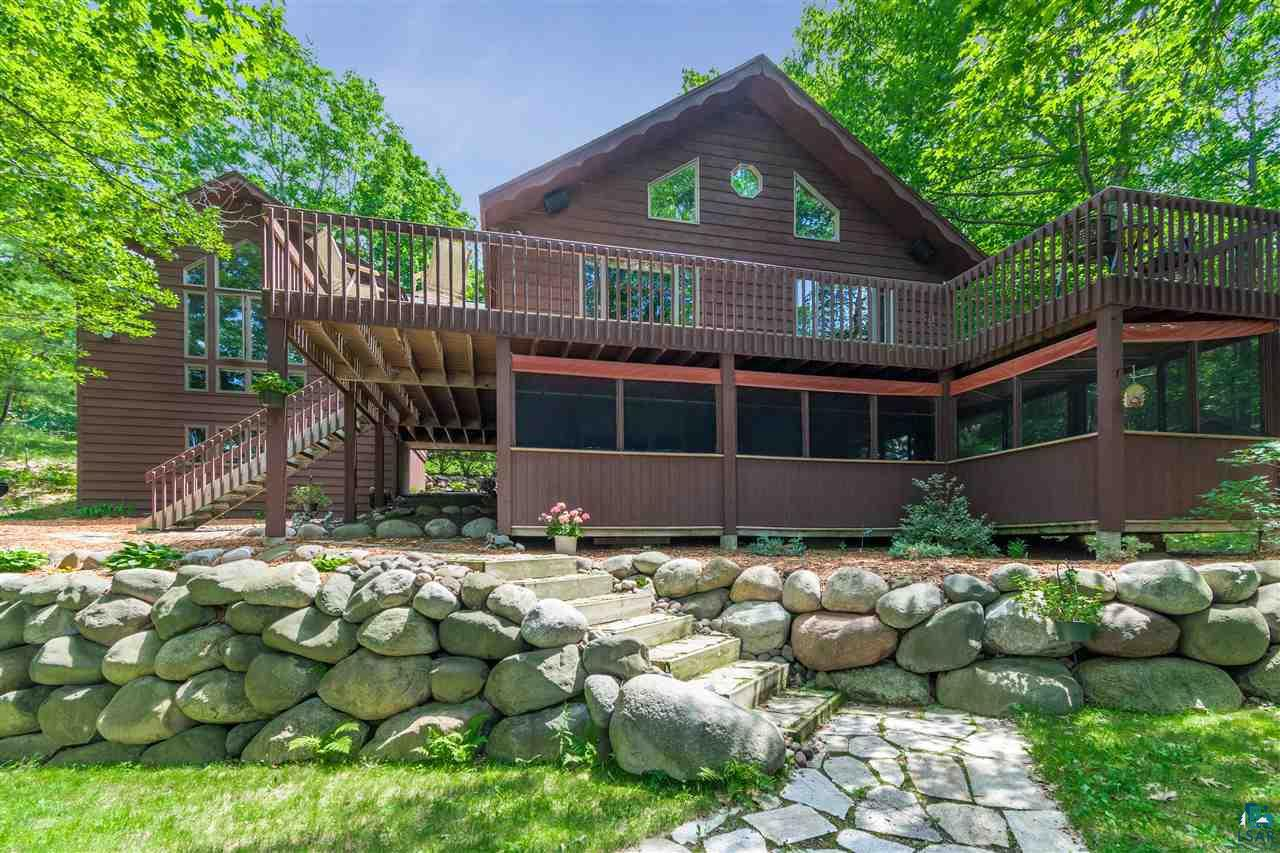 Stunning lake home with 171' of shoreline on Lake Nebagamon! This beautiful home has both panoramic lake views and wooded privacy. 20' vaulted ceilings, open kitchen, living & dining rooms with a loft overlooking the main floor. The master bedroom includes a gas fireplace, walk-in closet, even more amazing views, and a bonus area. The lower level features a sauna, walk-out family room, 2 bedrooms (non-egress), a 3/4 bath, and additional space to finish. Other features: large, maintenance-free deck, Anderson windows.