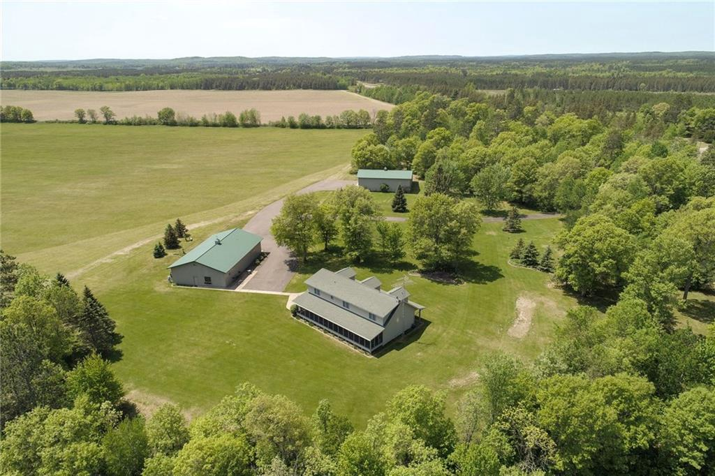 Well built & maintained Estate! Make this your 2nd home or main stay. Truly a must see-One Stop place-wildlife/hunting/fishing/trails for Horseback riding/ATV/Snowmobiling. Located within 2 hours to Eau Claire/1 hr to Rice Lake/under 3 hours to Mpls. Several spots to sit & enjoy the views on the property(one is an attached 60x10 relaxing screened porch)-yes, wildlife walks up in yard for your enjoyment! Home offers spacious kitchen/dining/large foyer/formal dining. See Amenities in attachments