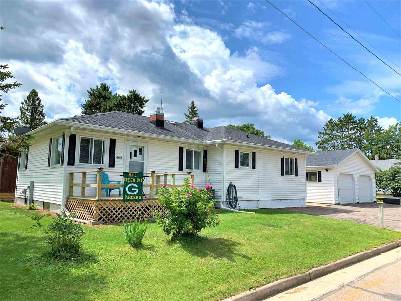 Why throw money away renting when you can buy!  Very nicely maintained, move in ready home for your consideration!  Beautiful curb appeal with manicured lawn, rose bushes and lilacs.  Driveway is all concrete that extends in between the house and the garage.  It makes for easy clearing of snow in the winter and limits tracking in dirt during the summer.  There is also ample parking.  The over sized 2 stall garage is insulated and heated, has work area, well lighted and access to a sand pit well for water.,Patio area with electric canopy between the garage and home makes a perfect area be outside yet out of sun, whether it be coffee in the morning, midday break or relaxing in the evening.  Step inside and you will enjoy main level laundry, 2 bedrooms on opposite ends of the home and main floor bath.  The bathroom has a walk-in tub with whirlpool jets and shower.  There are grab bars for safety. Nice sized living room with a gas fireplace, perfect for those Wisconsin winter nights!  New front deck off the living room. Electrical panel and wiring with 200 amp service updated in 2017 along with a new furnace and water heater.  Enjoy the central air in the summer!  There is also an additional laundry hook up in the lower level.  The basement is clean and dry!  This lovely home has so much to offer its new owners!  Don't wait to schedule your private showing today!