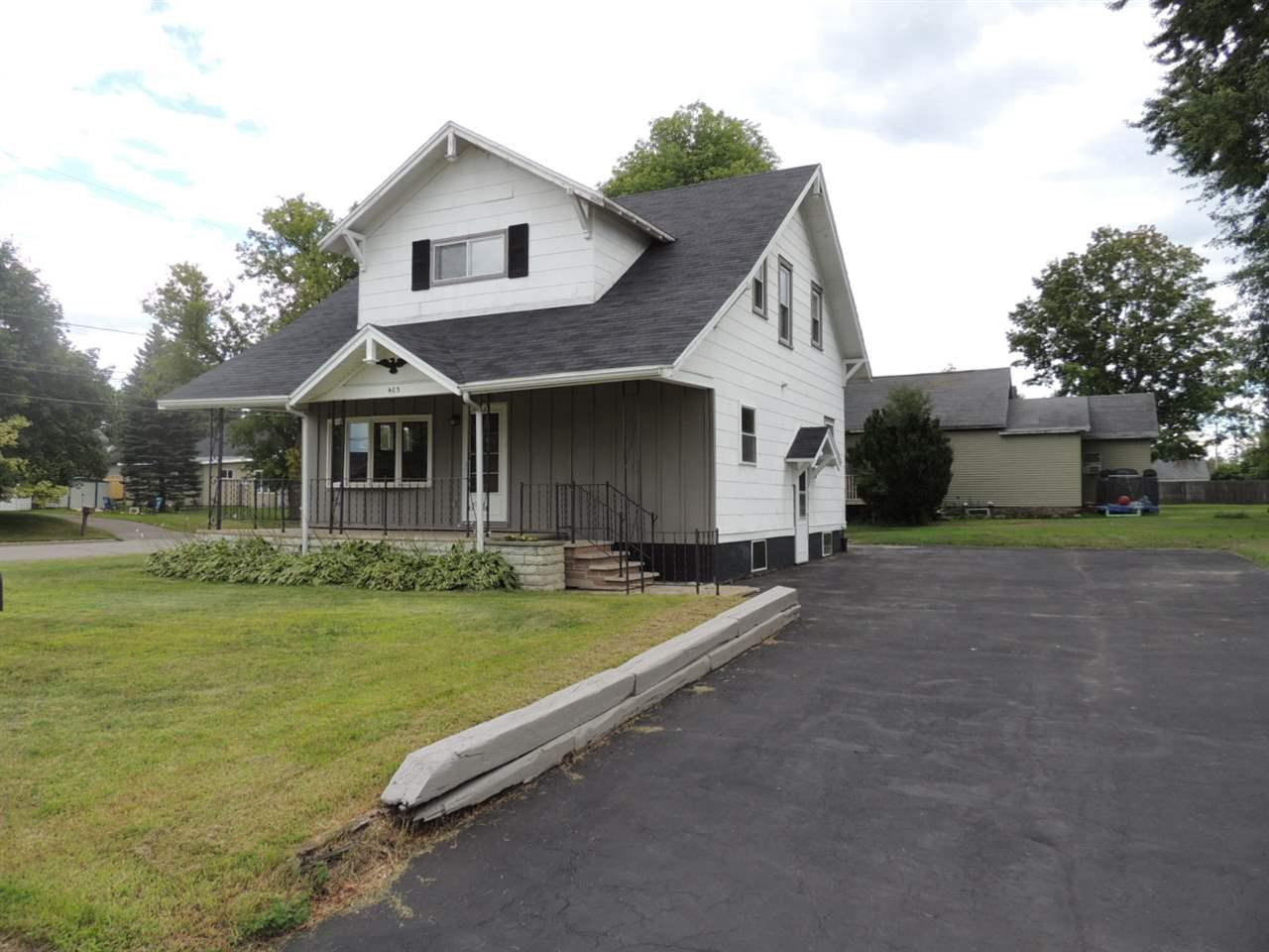 Very spacious 3 bed 2 bath updated home. Open concept main floor with office/den with full bathroom. Updated windows, all new paint and flooring. Updated kitchen with mostly newer cabinets. 2nd Floor has 3 bedrooms with more than ample closet space and a full bathroom. Clean full basement with laundry area. 20x9 Covered front porch. Attached smaller 1 car garage, a small storage shed and black top driveway. Priced to sell.. COME SEE!!