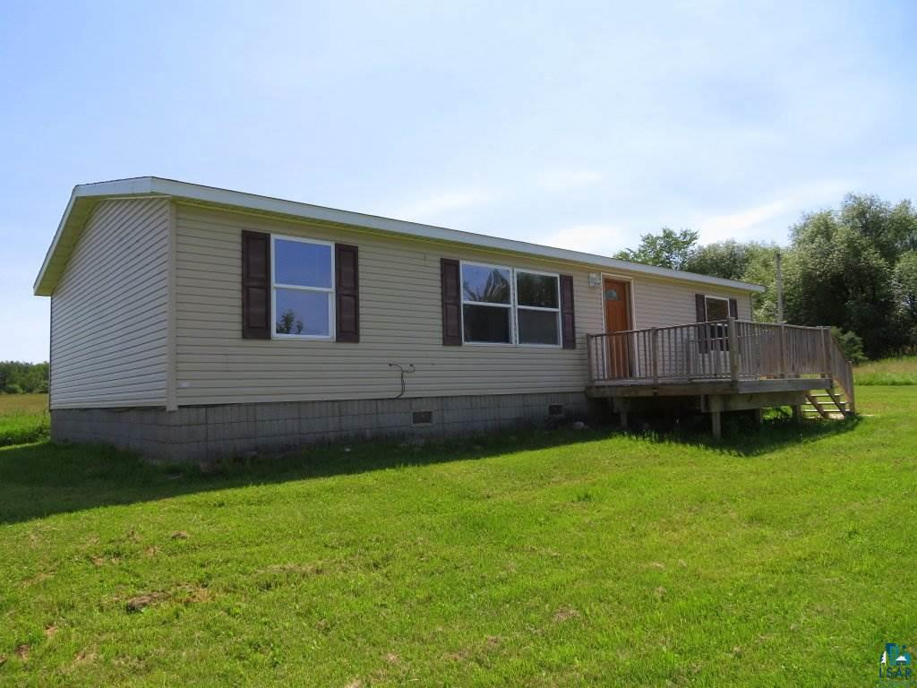 Want a nice, 3BR/2BA home in the Maple School District? This 2002 manufactured home has been nicely updated and you'll enjoy the beautiful acreage. The home was placed upon a concrete slab and with 30 arcres there is ample room for you to build any size garage you need. Take advantage of the low mortgage interest rates !