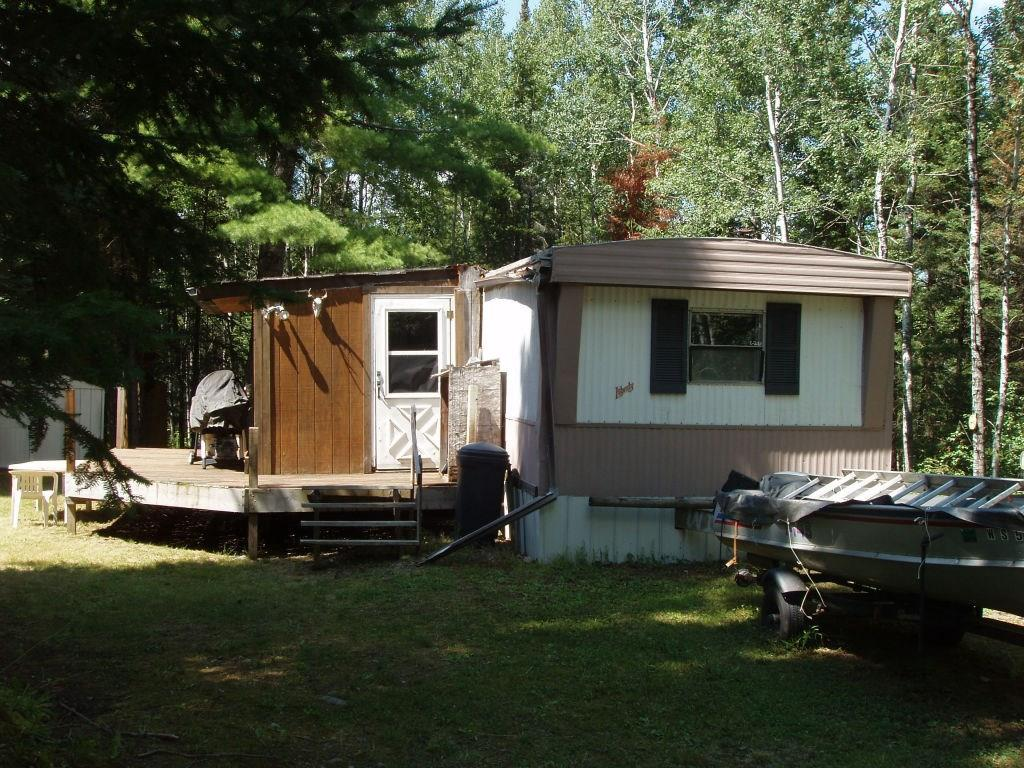 (965) Hunting Camp/Weekend Retreat! This 5+/- acre parcel on Morse Rd. north of Glidden can be the starting point for numerous ?Up North? adventures. Two bedroom mobile home. Privy. Small storage shed. Large block of Chequamegon National Forest lands across the road. ATV and snowmobile trails readily accessible from this location. $28,900 (8-43N-2W)
