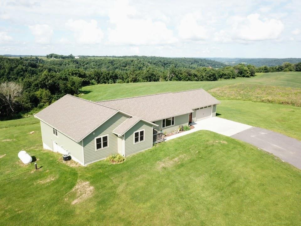 Hard to Find Treasure! Gorgeous acreage surround this custom built ranch home plus outbuilding.  Granite throughout, Amish cabinetry & many upgraded features.   Owner is a contractor & built this home for his own family so you know he didn't cut corners!  The ext. bldg has a 32X40 heated workshop w/ 12' overhead door. The back of the bldf is set up with stalls, feed storage & water, ready for your horses or other livestock.  The views are a must see! The land is til. & wooded w/springs, all on a dead end road.  Only 20 mins. to Tomah. 62+ total acres for $480,000. Acreage at $380,000 approx. 15 to be determined by buy. &  slr w/accept. offer.