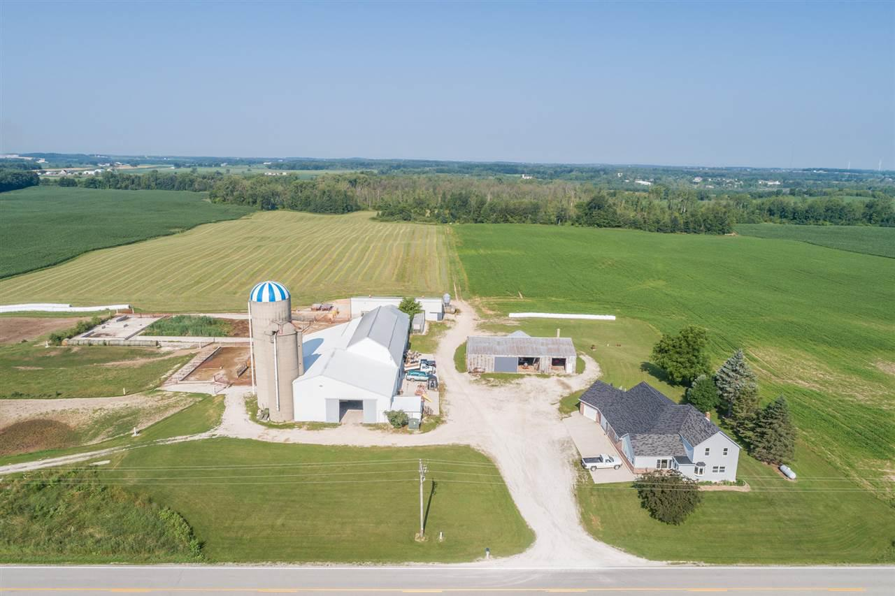 Completely updated and modernized farm home with newer addition. 40 acres & numerous Farm outbuildings being used for raising beef animal with labor efficiency in mind. Spacious home open flowing floor plan. Beautiful kitchen with abundance of natural light, large pantry & Stainless steel appliance package. 1st floor Master suite with full bath & walk in closet. 2 fireplaces, dry bar & office space all on the main level. Property may also be purchased with only 6.5 acres and the buildings at $389,000. Barns have multiple pens with self locking head gates. Concrete yard and manure storage.