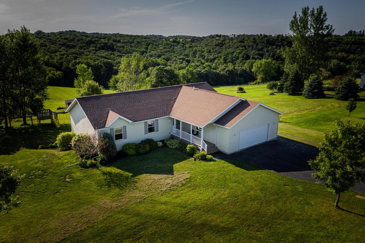 What an amazing opportunity!!  This sprawling ranch rests on over 5 acres with views to the west that will create memories that will last a lifetime!  Sunsets will close out your days! 5 bedrooms & 3 baths with open concept living just 9 miles from 14/61 & 35 intersection!  The horses can graze, the children can play, the adults can explore. So many possibilities remain!  Don't miss the detached studio/home office out back!  Call today for a private showing of this spectacular residence!