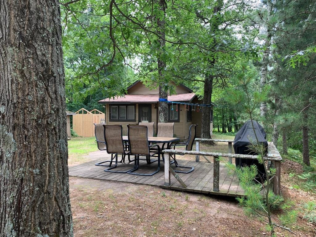 200' on beautiful Des Moines Lake in the popular Webb Lake area! Year around two bedroom, one bath west facing, move-in ready cabin on a quiet dead-end road. Furniture and docks are included. Newer oversized garage with bunk house - has bathroom, one bedroom, kitchen and living area. Heavily wooded for privacy. Near ATV and snowmobile trails. Vacant lot next door with 238' of shoreline also listed for sale.