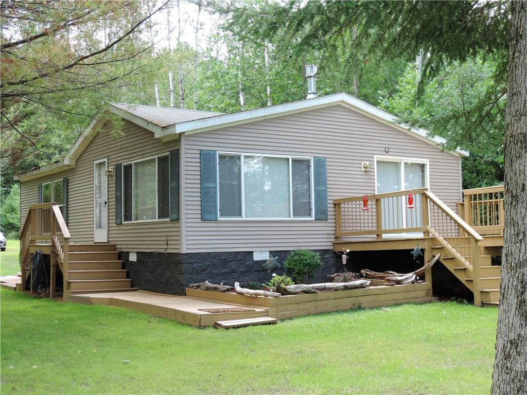 Fishing on the St Croix Flowage is AMAZING, along with the privacy, this one is a GEM!  This very well cared for Manufactured home, has plenty of space, in and out, with all the recreational activities just outside your door. Fish year round, ATV, snowmobile, trail ride, you name it. Imagine, entering your own place on the Lake with huge windows for panoramic views, a very nice kitchen to enjoy the fresh catch of the day, and a master with an amazing private bath. It can easily be yours.