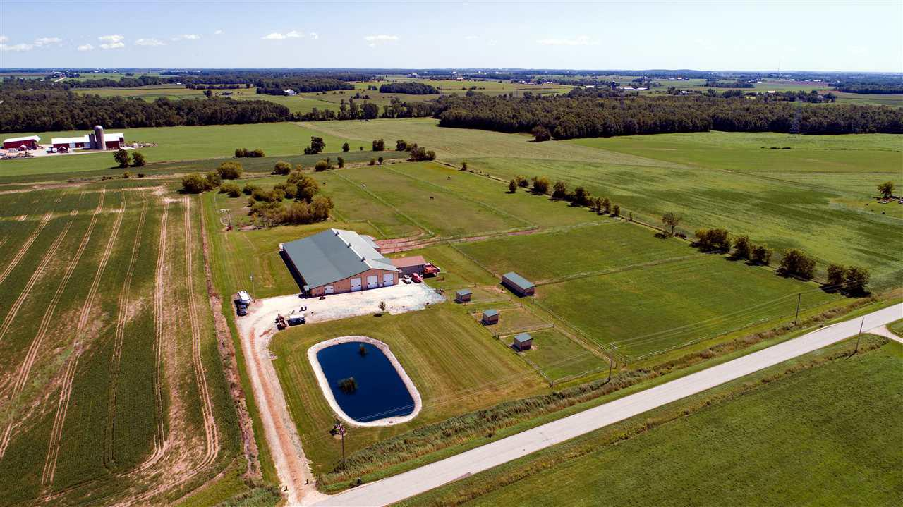WHERE EVERY HORSE WOULD WANT to be at...Meadowland Farms.  Just N of Brillion is this sensational 15-acre horse farm w/attached living quarters which includes 2400SF of quality living w/3BR, 2.5BA, office w/viewing of indoor riding arena, attached garage and was built by Dugan Builders in 2006.  Enjoy a 100x200 building w/18 heated horse stalls, 60x150 indoor riding arena, 2 tacks rooms, hay shed & shoeing shop & stocked pond.  NEED A HORSE REHAB AREA? there are 3, 60x60 fenced rehab areas.   Deluxe farm w/3+ fenced pastures.  Start your own business or take over the current one. BY APPT only