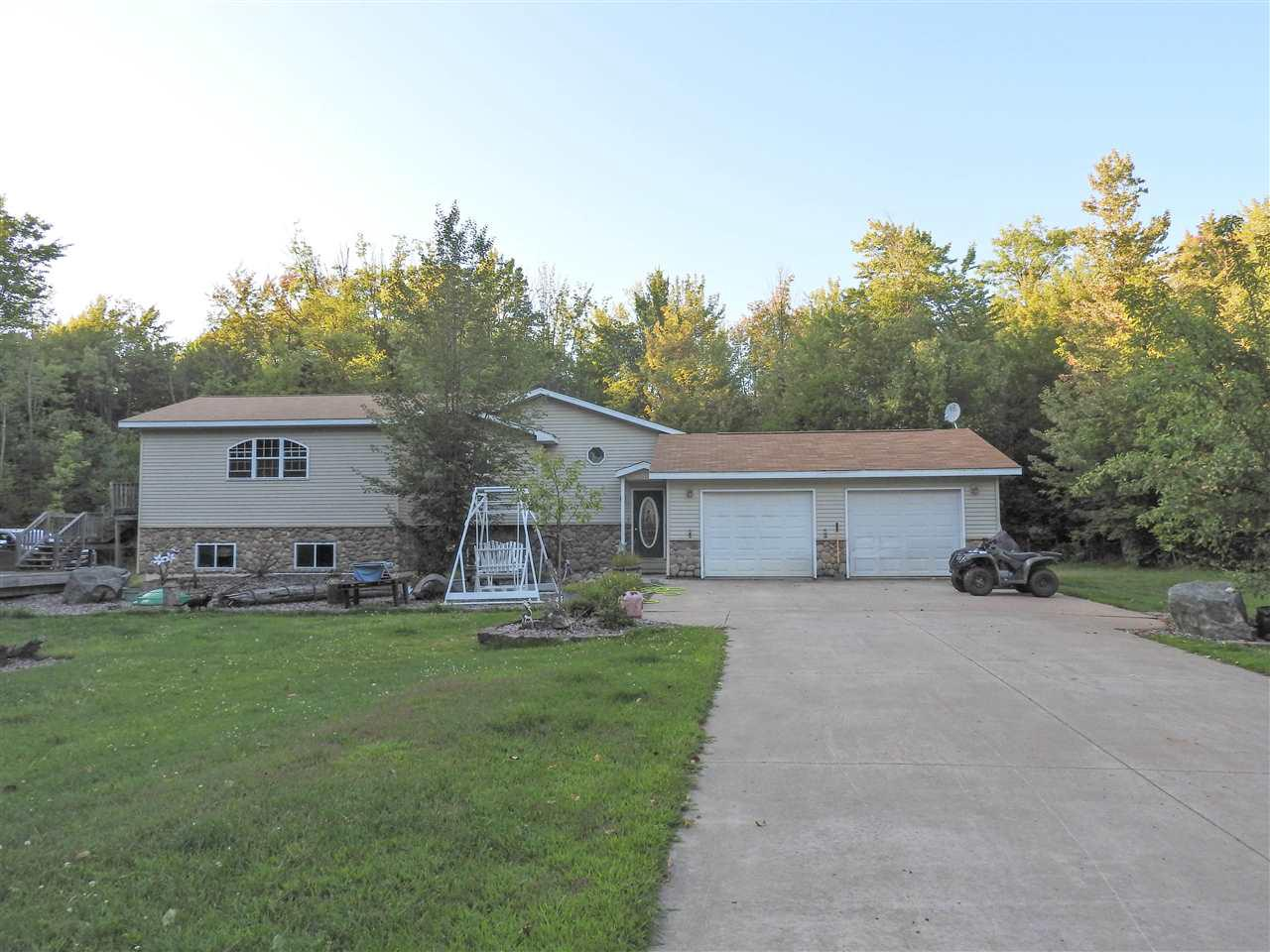 Superbly built 4 bed, 2 bath bi-level, raised ranch home located on 30.52 acres. Accompanied by a 3 acre private pond, boat house/exterior building, logging trails, detached/insulated 4-car garage, attached/heated 2+ car garage, spa/hot tub inside enclosed gazebo/cabana, and tanning bed. Property also hosts apple trees, walnut trees, peach trees, blackberry bushes, raspberry bushes, and blueberry bushes.,Parcel: 010-00470-0001 included in sale. Also included: 2 chest freezers, 2 refrigerators, tractor (2012 Bobcat 338) w/bush hog, rototiller, box scraper, ATV/4-wheeler (2018 Honda Recon), and lawn mower.