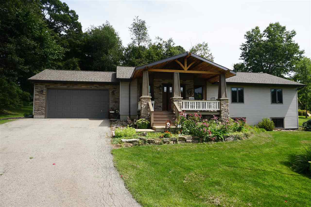 Come rock your cares away in the open air and enjoy the view from this gorgeous porch. This perfect country property is located just south of Tomah! As you step inside the prairie style entry, this 3BR/3BA home welcomes you with open arms. All is move-in condition with beautiful hardwood floors, extra storage room, laundry on first floor and all appliances included! You'll enjoy the comfortable lower level Familyroom warmed by gas fireplace, plenty of room for table games in the adjoining rec-room and the den/4th BR with 3pc BA. The horse barn has 3 stalls and property is fenced. Call today and see this great property! We're ready for you!