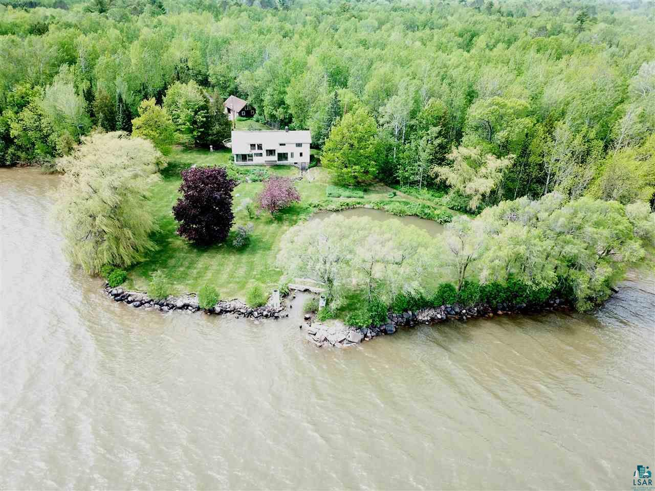 No doubt on e of the nicest parcels on the Chequamegon Bay of Lake Superior!  Parklike setting with your own lagoon that the sellers have docked a boat in the past.  Level lakeshore point with sunrise views.  3 bedroom, 1 bath home with a detached garage.  Awesome fishing from this shoreline.  Stone fireplace for relaxing in front of during the winter months on the lake.