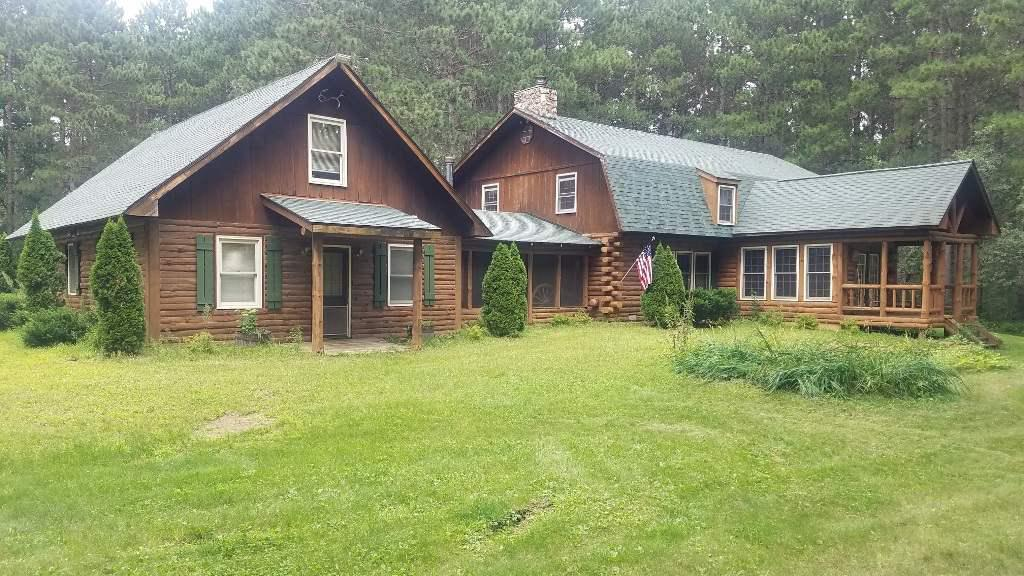 Great Vacation Rental Property !! - Log Home Lodge with 3 kitchens / 5 baths / Bar / 36'x52' Pole Building and so much more. This makes for a great family retreat, bed & breakfast, rental cabin, or ??? There is also a separate, but attached guest cabin, 2 fireplaces, 2 decks, a fire pit & deeded access to horse trails. This property is just a short walk away from Castle Rock Lake and you can ATV or snowmobile right from this property. VRBO is just one of the many great options for use of this unique property.
