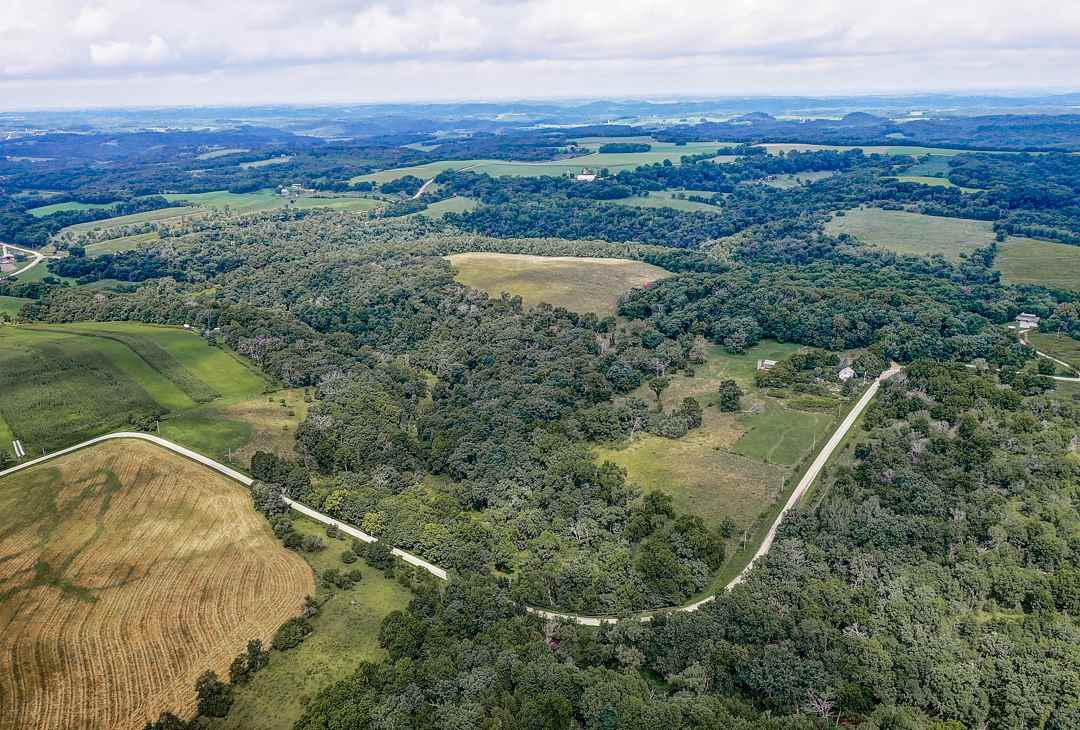 110 acres of Wisconsin?s natural beauty?Dodgeville. Enjoy a quiet retirement in the quaint farmhouse surrounded by hunting grounds, trout streams, and 150 species of perennials, or build your dream home from the ground up on an adjacent building site. As part of the Managed Forest program, the property reaps tax benefits and potential logging income. Live off the land: natural setting offers excellent opportunities for hunting, fishing, livestock grazing and organic gardening. Trails, hills and lookout points provide year round recreation. Incl well and septic (2010), outbuildings and 2BR house w/antique wood cook stove, SS Wolf range & more!