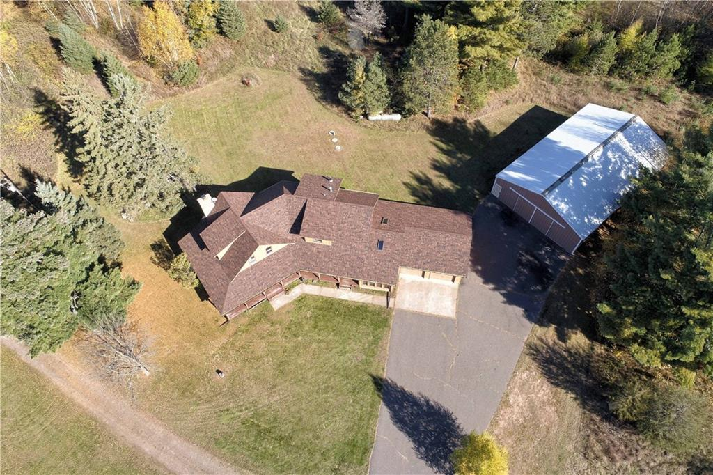 640 incredible acres of gorgeous paradise on the Totagatic River w/ your own, 100% private 36 acre lake - Loon Lake! (acreage includes lake). Located in Douglas & Washburn Counties. Over 5 miles of excellent access trails. Multiple creeks. Premier fishing and hunting land - white tail deer, black bear, ruff grouse & trophy Bluegill! Less than 20 min to Hayward, 1 hour to Duluth/Twin Ports, & 2 hours to the Twin Cities! Beautiful cabin w multiple species of solid hardwood paneling throughout