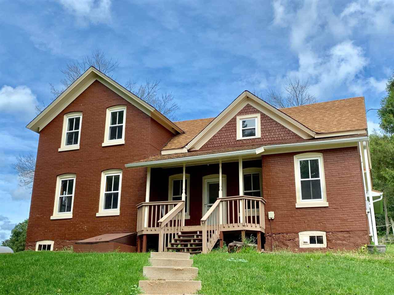 Be the King or Queen of the HILL!! This brick home was built strong on the Eastern hill/bluff of Elroy.  This home faces the Eastern morning sun and is just West of the Elroy Fair grounds area.  3-4 bedrooms this home has a lot of potential and has updated electrical and a furnace that's 8 years old. As of this past summer seller installed a new roof, carpet, and Air Conditioner! Additionally there is a 18x36 pole shed with 18 ft side walls and 36x24 detached garage. Wood stove in great room and the septic has recently been inspected. Perfect for horses or other farm animals! Call soon for your appointment to see this beautiful country home!