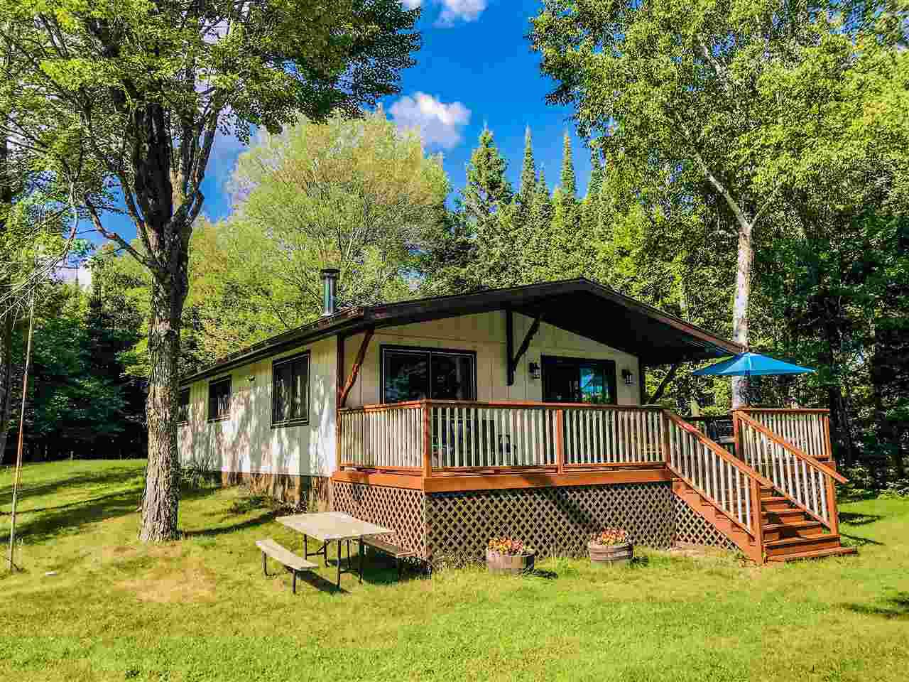 """ALL MEASUREMENTS ARE APPROXIMATE. BUYER TO VERIFY ALL DATA"",Very well maintained Manson Lake cabin/home with level sand frontage. Kitchen has a large breakfast bar and nice dinning area over looking the frontage. Living room has a wood stove with blower and open layout with be a great space to gather. 3 bedrooms, remodeled full bath and nice laundry room and walk-in pantry for storage. Property is between Tomahawk and Rhinelander with easy access. Fully furnished and other lake items negotiable. Manson Lake is known for it's clear water."