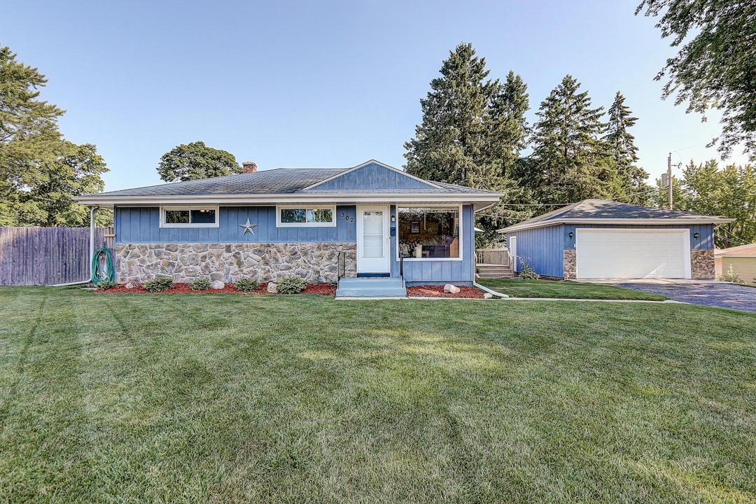 Must see! Well maintained Grafton ranch home on quiet street boasts magazine-worthy family room with gorgeous full wall stone natural fireplace! Family room is open to dining room and kitchen. Move-in ready condition! Updated kitchen with breakfast bar includes all appliances. Remodeled full bathroom with pedestal sink and shiplap walls. Main level half bathroom. Finished lower level with rec room, wet bar, bonus room, and second full bathroom! Deck off family room and second deck at back of home provides plenty of outdoor entertainment space! Above-ground pool, fenced yard. Detached garage. Make your move!