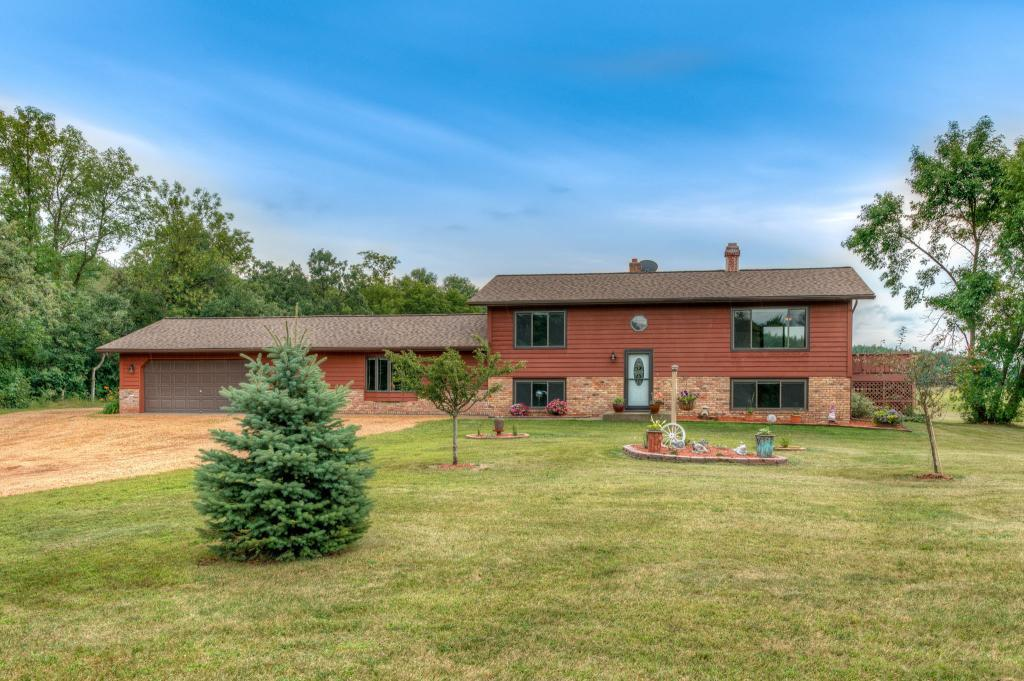 Great country home with possibilities of a hobby farm located on 5 acres in the New Richmond School District!  This spacious 4+ bedroom home with many updates and a 30'x50' pole shed is a rare find. Breath the fresh country air and enjoy the peace and quiet that is hard to find in this location. Enjoy the beautiful wooded views from the large deck located off the dining area. You will love spending holidays and weekends entertaining in the large 24'x26' great room with outside views through the patio door.   The maintenance and updating has been done including new windows, patio doors, roof, newer high efficiency furnace and AC, and freshly stained cedar siding and deck.   The tastefully renovated main level bath with a heated soaking tub, along with fresh paint throughout means there is nothing to do but move in and start making memories right away. With a short commute to the Minneapolis/ St. Paul metro areas you have it all- big city conveniences and peaceful country living.