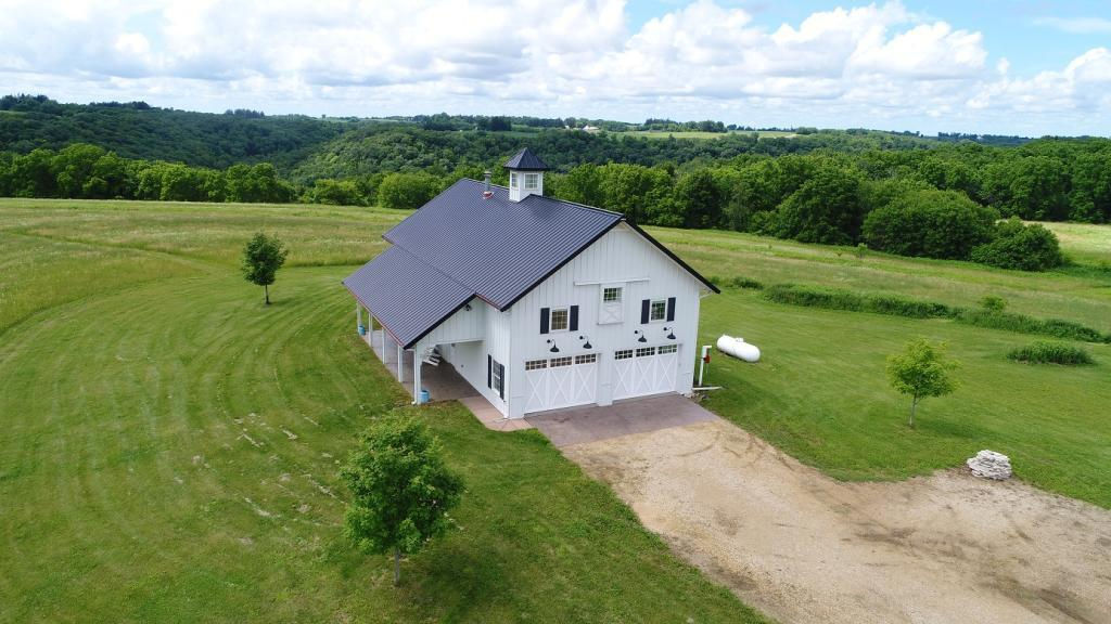 Roughly 65 acres with stunning views and exquisite living quarters located in the exclusive Bogus Creek Valley only 4 miles from Lake Pepin. The perfect family getaway with activities for all ages and interests. Commanding views in all directions, lg kitchen, 18? stone fireplace, 40? porch and 2 patios, make this the perfect setting for the entire family. 2-zone furnace, A/C and in-floor heat ready. One-owner weekend property available due to executive relocation. The land includes roughly 42 acres of wooded bluffs with plentiful walnut and oak. The remaining 22 acres planted in clover, alfalfa, tall-prairie CRP, pollinator habitat and whitetail/turkey food plots. Outstanding trophy deer hunting property that hunts more like 120 acres with top bluff access, 5 distinct ravines and land ownership extending to the valley floor. Easy access to the Lake Pepin marina, top restaurants/farm pizzas, antique shops and more from this peaceful, quiet and scenic slice of wildlife heaven.