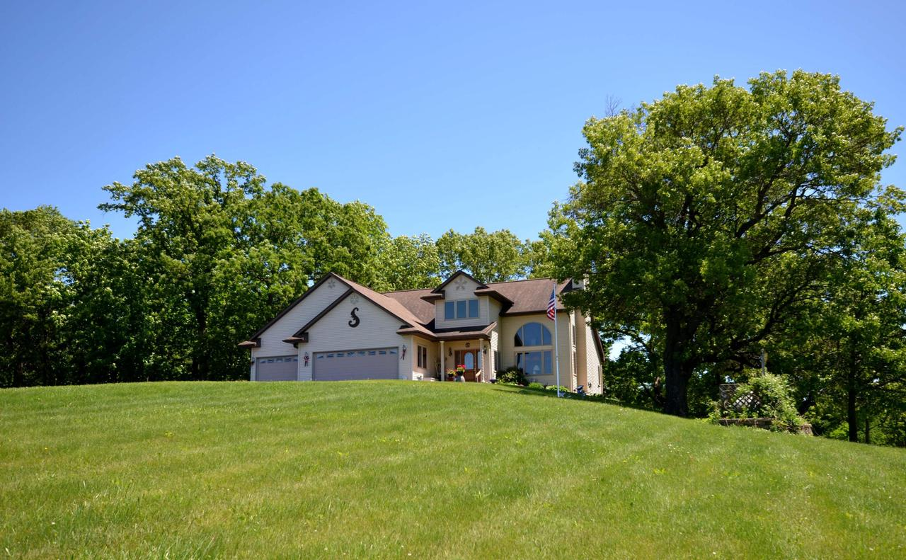 A beautiful, well thought-out home on 15.46 +/- acres of land within a mile of Viroqua is a rarity. Having one on the market is an opportunity for a buyer that doesn't come along very often. 9', 15', & 18' ceilings. Hardwood floors. Many windows & natural light. Beautiful master bathroom w/ walk in glass block shower.   Geothermal heating & cooling w/ dual fuel backup electric ceramic heater & propane generator. heated garage,  50' x 30' pole shed w/ 100 amp service & welding plug. 7-acres of tillable land are currently rented. Could be used for pasturing horses or other animals. Close to shopping, schools, medical services, golf. Back deck overlooking fern & Hosta garden in a wooded setting attracting wildlife & providing privacy.