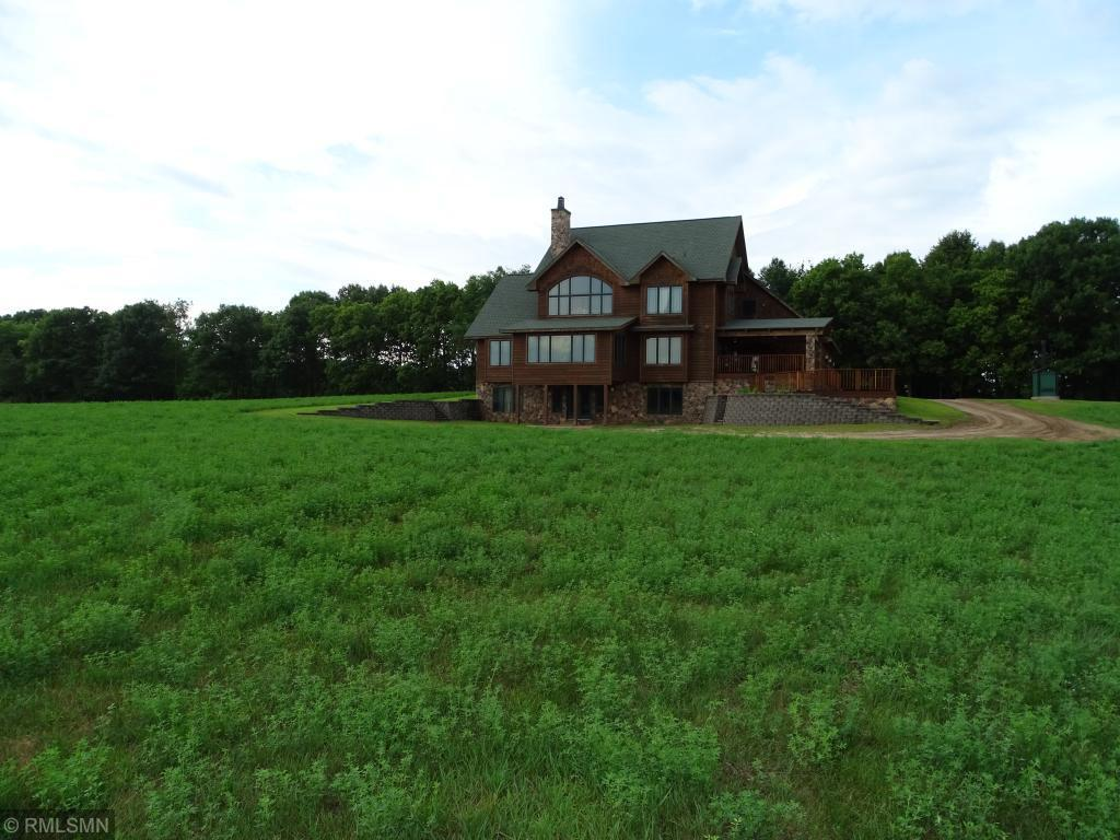 This custom built 5 bed, 4 bath country home is offered with 10 acres (more acreage is available), is located just 1.5 miles from Pepin and has beautiful panoramic views. This one of a kind, quality built property features many different hardwoods, two full kitchens and laundry rooms, vaulted ceilings, high end fixtures, cedar lined closets, 4-season room, large bedrooms, and an amazing bonus room. This property would be perfect for a large family, B & B, or horse lover. Priced way below cost!