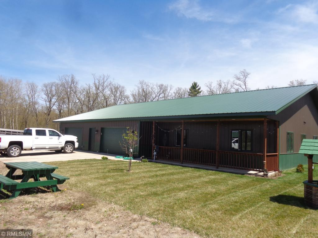 """Just about the ideal hobby farm setting - This very low maintenance home was custom built in 2016.   It has the SS appliances, granite counters and other upscale finishes.  Protected from the north and east by woods, watch your cattle to the west from the covered entry patio.  The floor plan has good separation from the MBR to the guest BR.  And the """"Man Cave"""" might be the favorite place to spend time. Even the garage is finished and has plenty of room for two full size trucks plus all the other things you'll have in the country.  The shop/cattle shed is well planned also."""