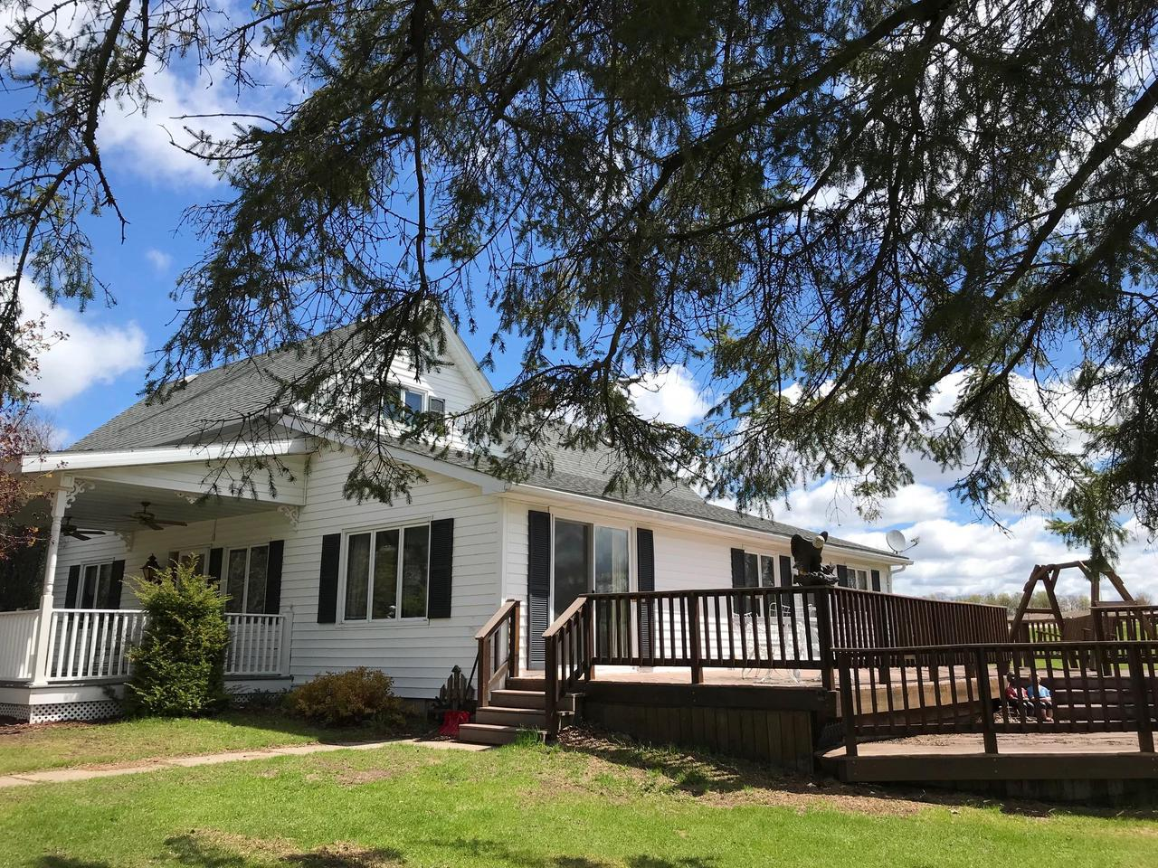 OUTLET CREEK-BUSINESS OPPORTUNITY-Have your home and business in the same location. 18.39 ACRES,  1 1/2  story original farm home  improvements in 1985, 4 bedroom, one bath ,mud room with shower.  two car garage, 40x60 barn, 60X80 multi-purpose, pole building heated and insulated with running water.   Blacktop driveway.  Awesome hunting, fishing, and ATV area.