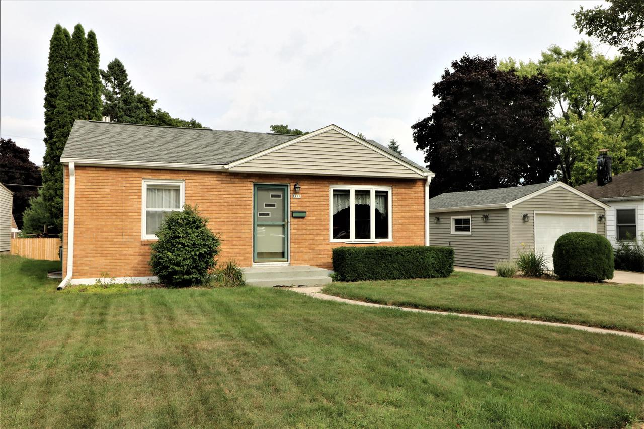 Larger than it looks, from the moment you enter, this will feel like home. Well cared for, warm and inviting, this 3 bedroom, 2 full bath Grafton ranch has plenty of charm. Beautiful hardwood and ceramic tile flooring.  Eat-in kitchen.  Plenty of living space for all.  Large family room for everyday living.  Dining area could also be used as a living room.  Large master bedroom.  Newer roof, insulated vinyl siding, and low maintenance trim on house and garage.  Large yard with deck. All appliances included. Lower rec room with walkout door.  Nothing to do here but move-in and enjoy.