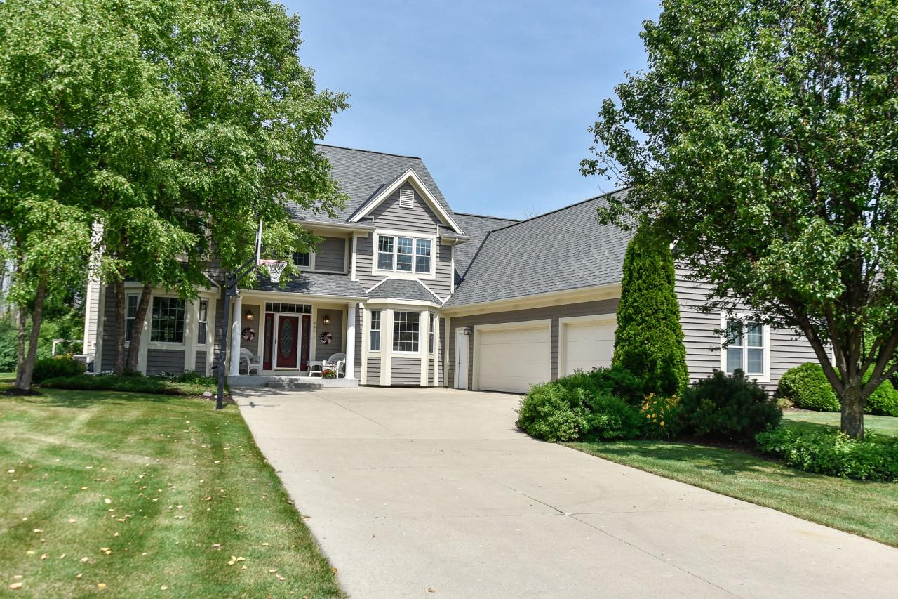 What an opportunity! Own 3.68 acres in the Village! Enjoy Village amenities, yet have room to explore and play on the fabulous wooded lot with frontage on Mole Creek! The house is stunning and has been masterfully maintained. So many updates! It includes a main floor 5th bedroom, an exquisite Master bathroom with a walk-in shower, double sink vanity and whirlpool tub and a fabulous finished lower level with a kitchenette, rec room and office. All rooms throughout the house are spacious. There are refinished wood floors, gorgeous cabinetry, new main floor carpet, updated appliances, and recent interior and exterior paint. The lot was professionally landscaped and has a beautiful new patio. Near Woodview school and local park in a cul du sac setting in one of Grafton's finest neighborhoods