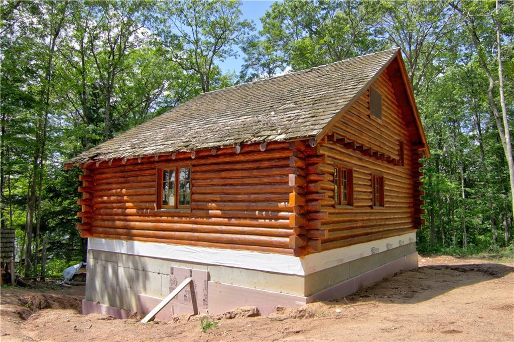 This authentic log cabin will be newly remodeled with 3 bedrooms and 2 1/2 baths with a fully finished walk-out lower level. Quintessential Northwoods style with log-beamed-vaulted ceilings and loads of Northwoods charm. Set on over an acre with tall pines, mixed hardwoods and an excellent view of the lake. Easy walk down the slope to the lake with a southwestly views and excellent swimming frontage. Plenty of room for a garage. Round Lake boasts two great restaurants, a marina with gas service and is a full recreation clear-water lake.
