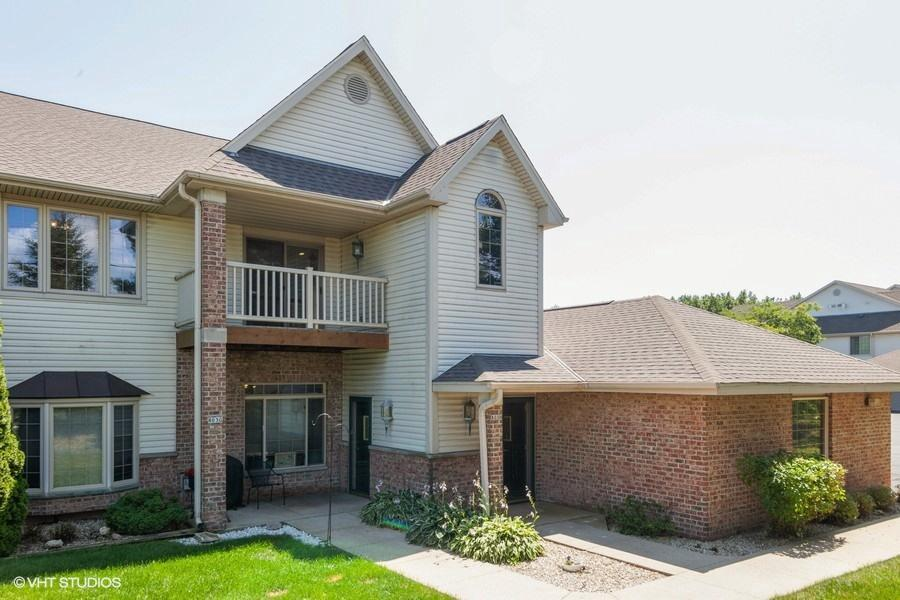 Enjoy carefree living and the Beechnut Woods lifestyle in this end unit. You'll have your own private entrance to this 2nd floor condo featuring 2 bedrooms, 2 full bath open-concept space with vaulted ceilings throughout. Relax with family and friends in front of the gas fireplace, While entertaining your guests you'll still be part of the fun from the adjoining kitchen with large pantry. Enjoy sunsets from the private balcony. Master bedroom has large walk-in closet & private bath. In addition you'll find the 2nd bedroom, 2nd bath and the office/den. There's in-unit laundry and 2-car garage. Just minutes from I-43 shopping, schools and restaurants.