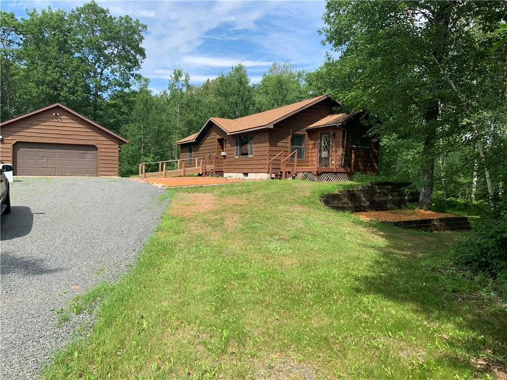 Enjoy the privacy on this 20 acres in Lake Nebagamon. This 2 bedroom ranch home has many updates including All new flooring on the main level, New paint and lighting. Vaulted Ceilings,  Main Floor Laundry, 24' x 30'  2 Car Garage and a 24' X 36' Northland Pole Building thats wired.  Lower level walk out with bathroom stubbed in. Newer roof on house and New roof on Garage June 2019. New Garage door to be installed in July. Other room is 9'x8' Porch/Mud room.