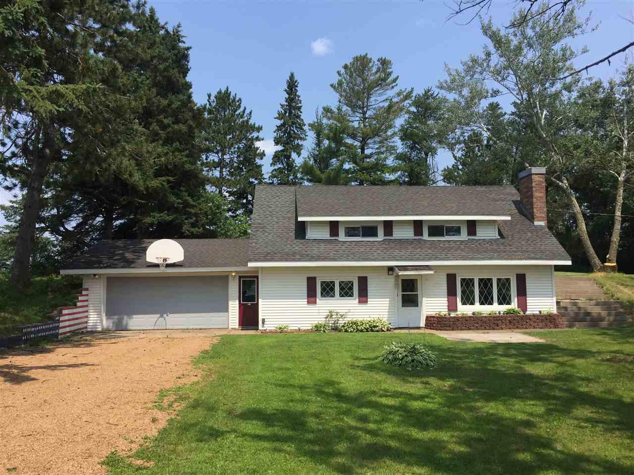 COUNTRY HOME CLOSE TO TOWN. 3 Bedroom home with 1 1/2 baths located just 2 miles from the west side of town and Antigo High School. Home's interior has been completely repainted and the laundry/garage entry/back room area and lower half bath has been newly tiled and it looks FANTASTIC! This home is situated on a beautiful one acre tree lined lot with manicured shaded lawn and flower beds. The property also has a great 54'x30' shop/steel building with a separate drive for ease of access and possible rental income for storage. The property had a new drilled well installed last year and there is an additional 14x12 steel storage shed in back. Spacious upper level bedrooms with full bath. Kitchen, living room with wood burning fireplace, laundry, and 1/2 bath on the main level. Call today to see this great country living opportunity