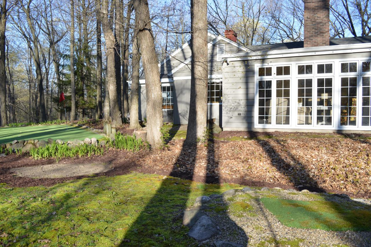 Peaceful, private, wooded lot - 5 min to town & public boat launches in town of West Bend - property taxes lower than city of WB. Lrg. open floor plan, perfect for fam life & entertaining. Lrg. deck. Finished LL. Beautiful 2 way NFP w/natural stone, huge windows,  NFP in LR, Pottery Barn light fix, Maple HWF, high end cabinets in KIT & Baths, Quartz countertops. High end pool table incl. Lrg. stone walls, mature trees, parking area & putting green. Detached building can be used as home off, man cave/she shed, kid's space or space for out of town guests - finished w/HWF, heat & air.