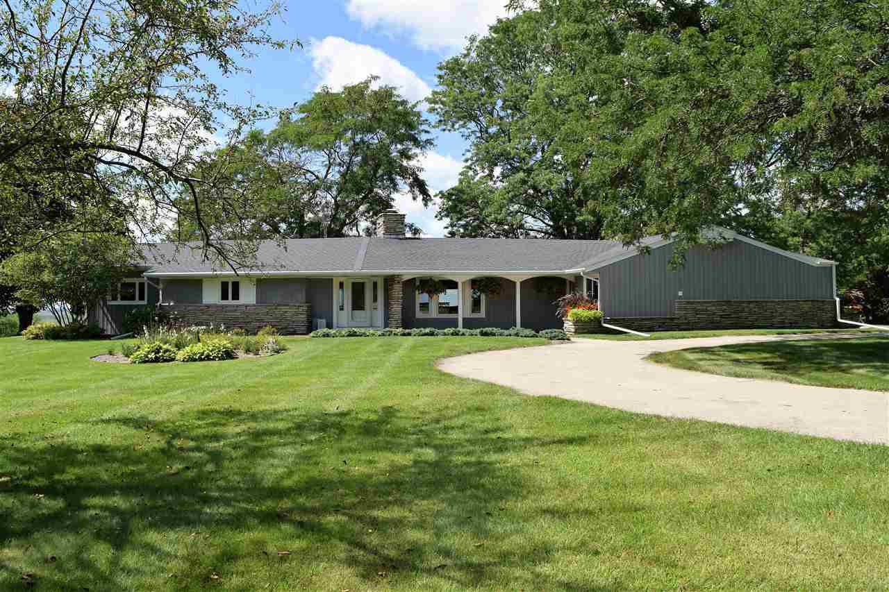 Overlooking the Horicon National Wildlife Refuge & situated on 13.81 acres. This unique 3 Bedroom, 2.5 Bath Ranch has over 2900 sq ft, an open concept design, a stunning stone fireplace and an abundance of windows to enjoy the Spectacular Views & wildlife! You`ll love the built-in?s 1st floor laundry & a master suite with dual closets, bath & access to the patio. The finished lower level rec- room is a great place to unwind. Attached Garage, 3 stall Horse Barn & Shed! Professional landscaping, concrete patio, a duck blind and a permanent deer stand outside. Country living- a short commute!