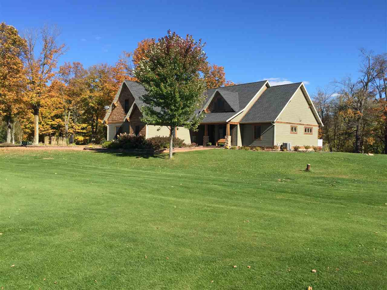Quality built one owner Craftsmanship home with stunning views of the Eau Claire river and the River View golf course.  This prestige home has 200 ft of frontage on the Eau Claire river (where you can kayak for miles) and  is located on  hole 2  of the golf course. This 5 bedroom, 3.5 bath offer's seperate living quarters: upper level has nice size living room with beautiful stone gas fireplace. Dinette with panaramic views of the river. Kitchen has granite counter tops and snack bar.,Formal dining room off front entrance.  Master bedroom with patio doors to deck looking out to the Eau Claire river, private bath with double vanity, soaking tub and walk in tile shower.  Lower level boost open concept living room with additional gas fireplace and  large kitchen and dining area.  2 more bedrooms, Office/work out room, laundry room and full bathroom. Walk out lower level with nice size patio for entertaining.  All kitchen appliances included.  Must see the beautiful professional landscaped yard!!
