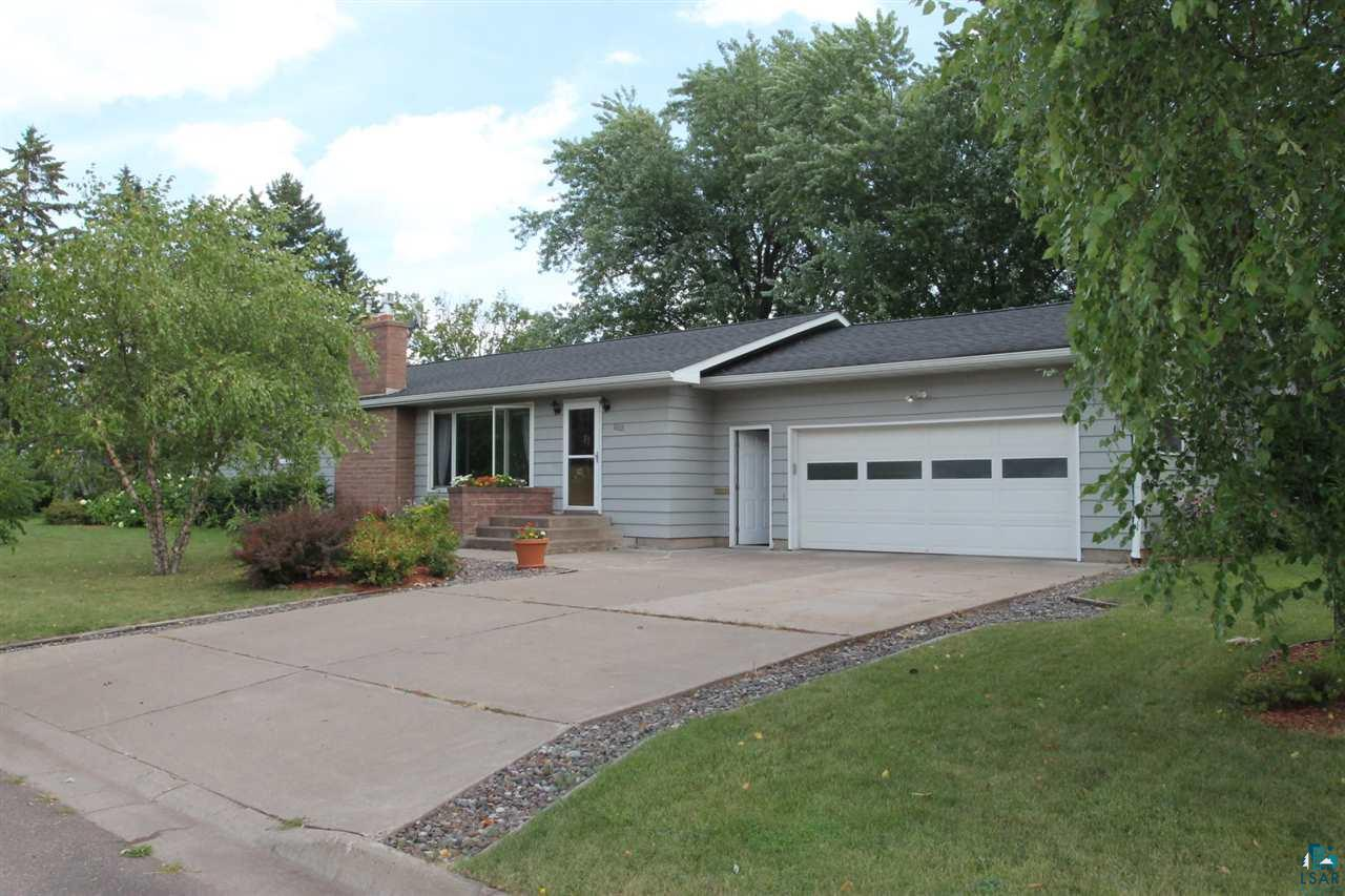Well maintained one level ranch on corner lot close to schools and hospital.  4 bedrooms, 2 bath, 2 car attached garage.  Finished family room in basement with addition bedroom with egress window.  2 fireplaces.  Open kitchen/dining room.  Private deck from kitchen.  Updated roof/furnace and electric panel.
