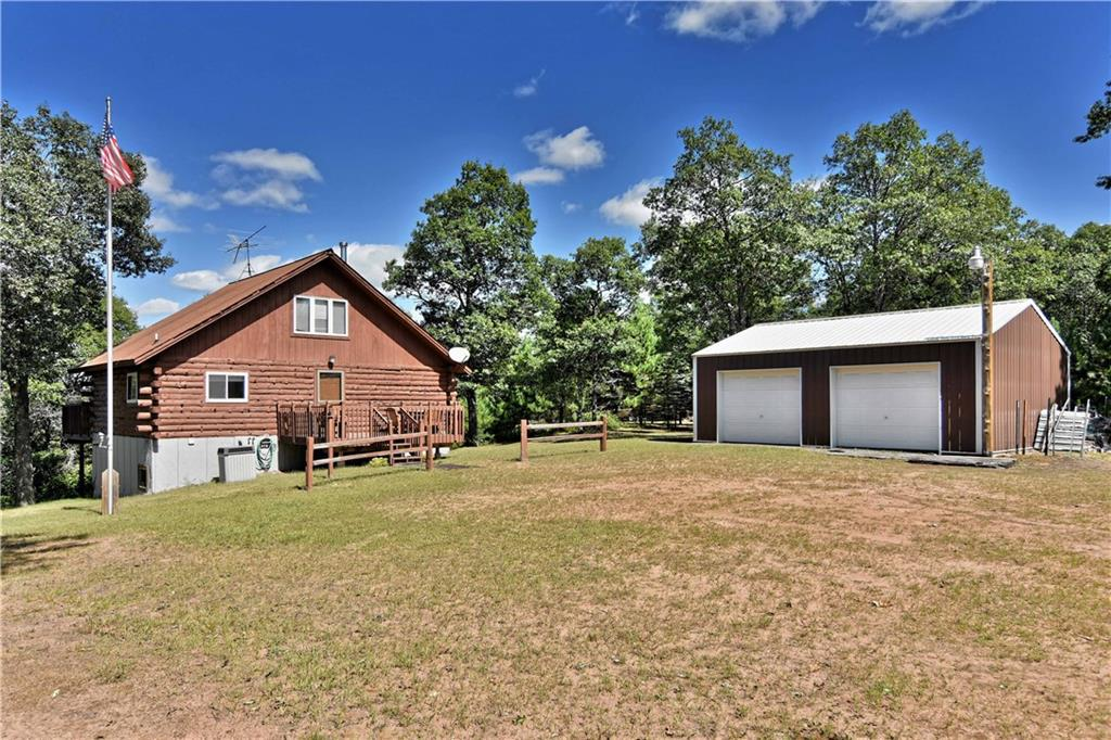 A true up north log cabin in a quiet setting on 200' frontage & over 2 acres. At the end of a cul-de-sac, no neighbors close. Sand based shore. Thousands of acres of county land near by; close to snowmobile and ATV trails. Chalet style, rustic interior. Lakeview deck at main level of cabin plus deck 7 steps to 2nd level & a third deck & steps to the lake. Detached 24 X 30 garage. Fire pit and sitting area in the yard. Level sand beach and play area at lakeside.Includes most all furnishings