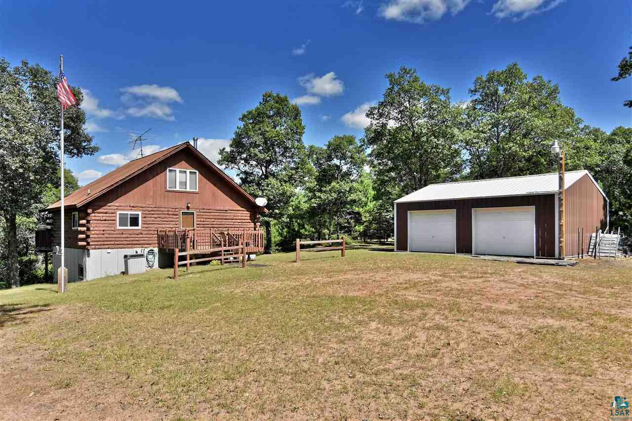 A true up north log cabin in a quiet setting on 200' frontage & over 2 acres. At the end of a cul-de-sac, no neighbors close. Sand based shore. Thousands of acres of county land near by; close to snowmobile and ATV trails. Chalet style, rustic interior. Lakeview deck at main level of cabin plus deck 7 steps to 2nd level & a third deck & steps to the lake. Detached 24 X 30 garage. Fire pit and sitting area in the yard. Level sand beach and play area at lakeside. Includes most all furnishings