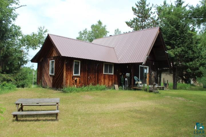 This is drop dead gorgeous property consisting of 80 acres with a rustic cabin, and two metal pole barns. The 2 bdrm, 1 bath cabin has kitchen, dining & great area, two bedrooms, a loft, 3 season porch and full basement. The original cabin (1978) was moved onto the new foundation along with an addition in 1993. One pole barn is 30x40. The other is 45x45 with an 18x45 lean-to. Both have cement floors and power. Rocky Run creek meanders across acres of lush hardwoods. There is apx 30 acres of open area.