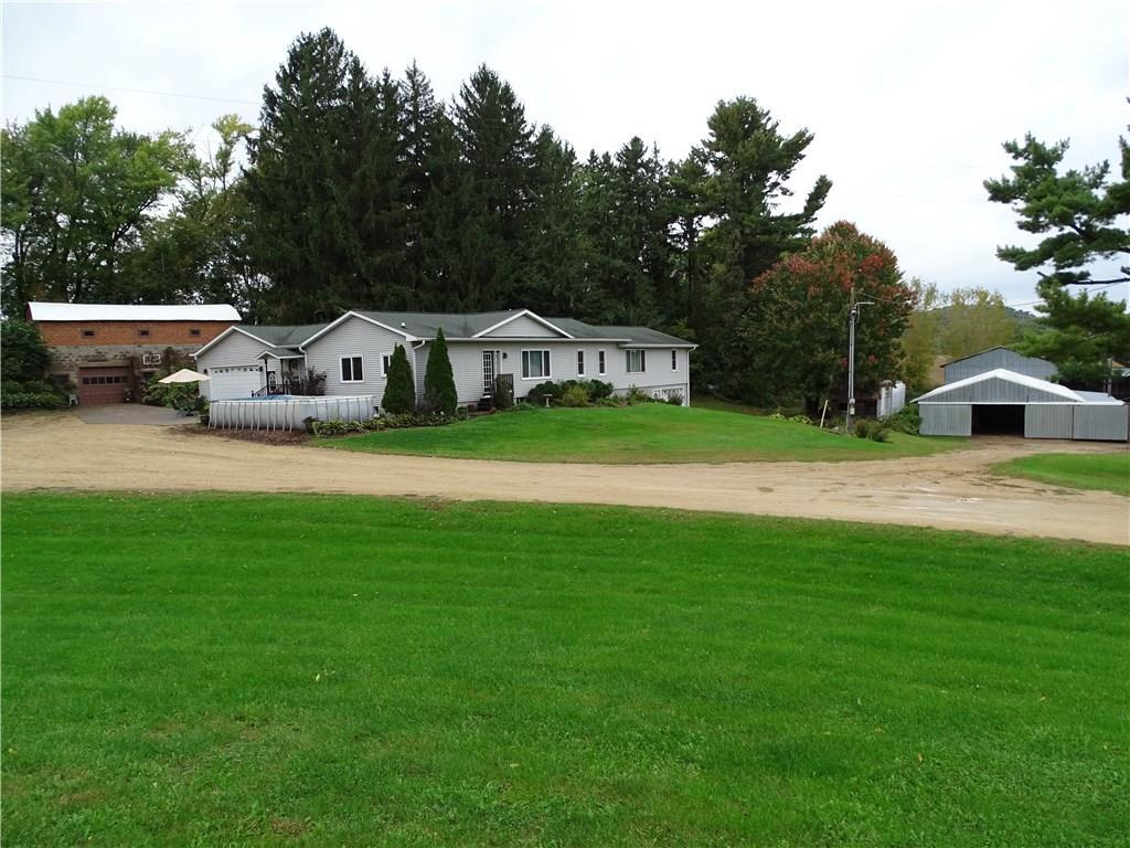 Very solid and well maintained 5 Bedroom, 3 Bath Ranch home on 60 acres with all the outbuildings for an excellent Hobby Farm set-up and perfect for horses or cattle. Enjoy over 2100 finished square feet all on main level. Finish off the walk-out lower level for even more space! Recent updates include siding, shingles, windows, flooring, 6-panel oak doors and more! Outbuildings include barn, lean-to, and pole building. The property is also available with less acreage.
