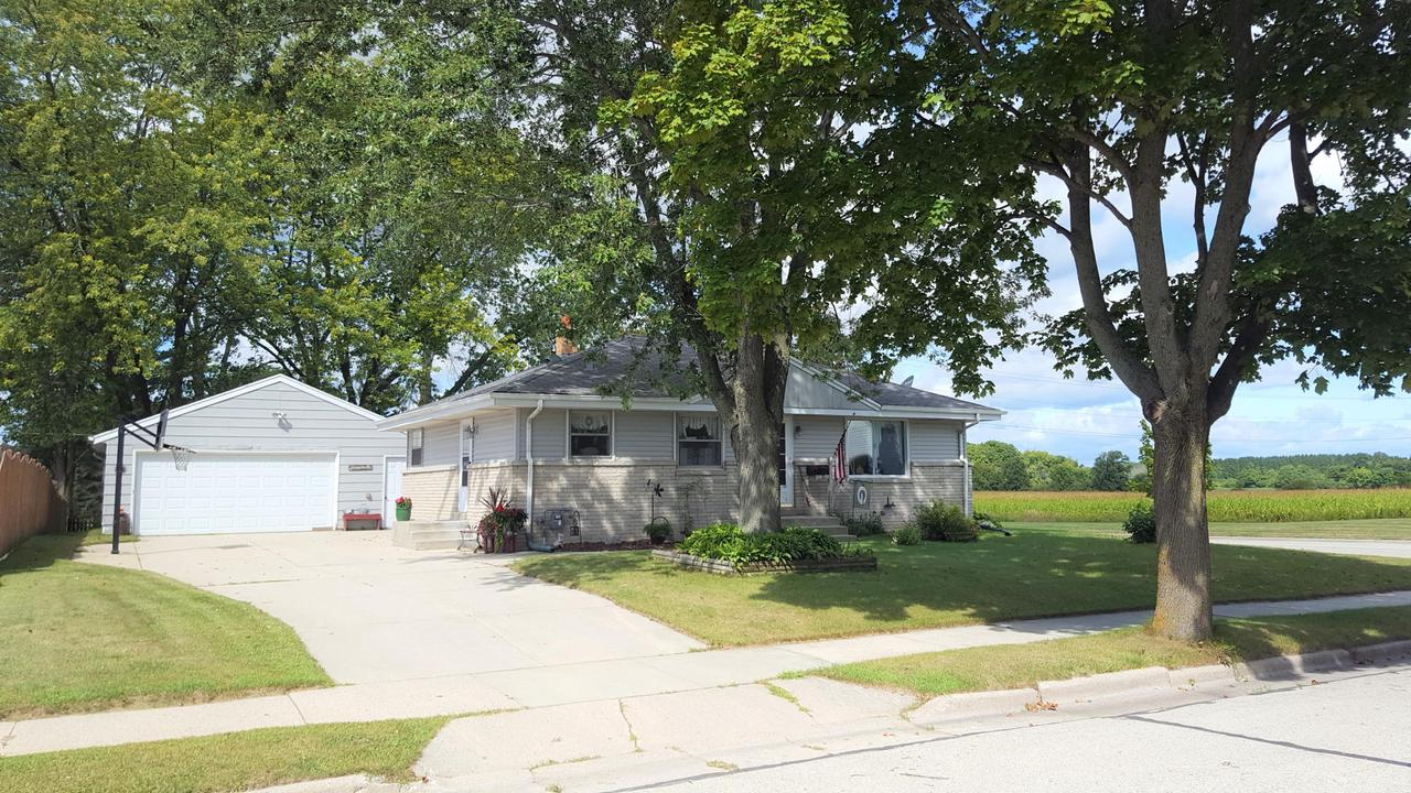 This cozy Ranch home has been lovingly cared for by the same owner for 53 years. The eat-in kitchen has plenty of cabinets. The sun filled living room has hardwood floors underneath the carpeting. All bedrooms also have hardwood floors. The basement offers a rec room and there is a workshop with bench and shelving. There is space for expansion and another bathroom. The home is located on a large corner lot with views of the countryside to the North. Conveniently located for all amenities the Village of Grafton has to offer.