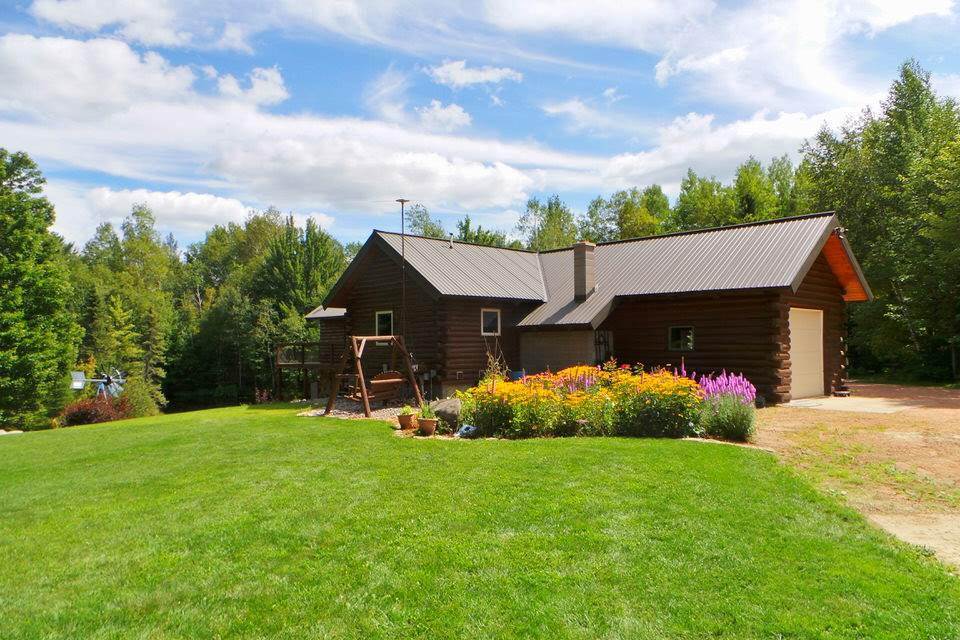 This beautiful two bedroom full log home is open concept w/a one car attached garage. It has a beautiful private pond next to the house. There is a 30x70 outbuilding w/40x24 lean to. The overhead accommodates a semi. It is 4.2 acres with frontage on Hwy 13. It has a horseshoe drive. The landscaped setting is gorgeous. About 9 miles north of Medford.