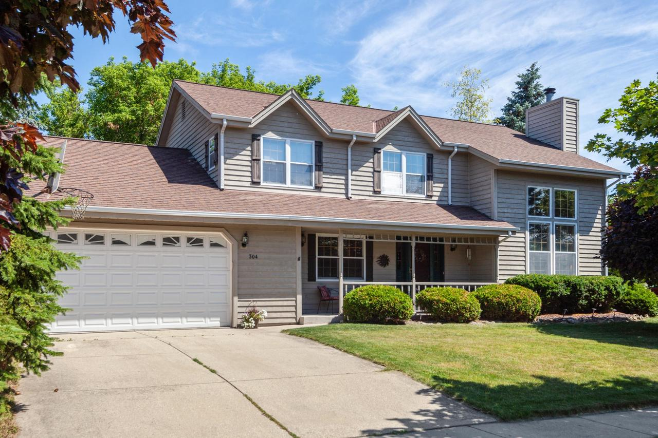 Spacious 4-bedroom, 3 full-bath home in desirable Cedarburg School District. Inviting living room with large windows, soaring ceilings, attractive fireplace, and formal dining area. Eat-in kitchen includes dinette, breakfast bar, and patio access. Additional main floor conveniences include full bathroom, guest bedroom (or home office), and laundry room. Private master suite with vaulted ceilings, dual closets, and en suite bathroom. Two additional bedrooms and a third full bathroom upstairs. Outdoor living spaces include two backyard patios in private, tree-lined greenspace, as well as, welcoming front porch with serene views of mature landscaping. Basement provides extra storage or opportunity for future expansion ideas. Attached garage has abundant extra storage space and high ceilings.