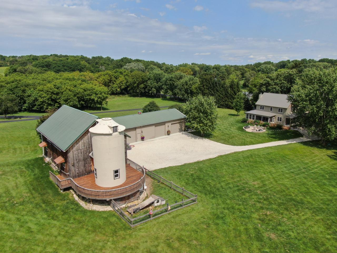 Ever dream of owning a magical piece of paradise? You found it! This unique property offers anything the imagination holds with a newly built farmhouse, 10 acres, 2 ponds, a pole building and a wood and fieldstone Barn. The Barn could be a wedding destination in itself with 2 floors of entertaining space, a silo bar, a 1/2 Bath and an attached area for your animals to live. Sip a glass of wine off your barn's circular refurbished deck overlooking green pastures. Set amongst 100 year oaks, maples, and apple trees, this rustic yet elegant home checks every box with 4 bedrooms, 3 baths, an open concept floorplan and a finished LLl. A main floor BR en-suite is can be used as a guest room while the MBR upstairs offers cathedral ceilings with barn wood details and a spa-like tiled bathroom.