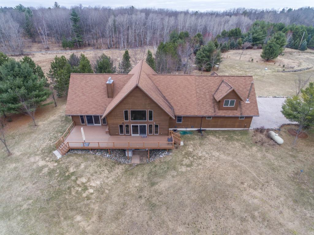 With a quick drive from Stillwater, this beautiful offers all the high style and customs for a 5BR/4BA on 8 Acres with 316 Ft Waterfront on Gilbert Lake! Built in 2007, Oak Hardwood Floors, Master Suite w/ Fireplace & Library, Andersen Windows, Spacious Kitchen w/ Custom Built-ins & Cambria Counters! 3 Fireplaces, Walkout Basement, Energy Efficient Geothermal Heating & Cooling! 1BR Apt above Garage, Heated Workshop, 12 Apple Tree Orchard! Private setting, gorgeous home! Must see!